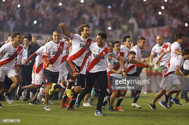 Leonardo Ponzio of River Plate celebrates with teammates after winning the second leg final match between River Plate and Atletico Nacional as part...