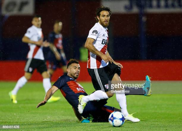 Leonardo Ponzio of River Plate fights for the ball with Denis Stracqualursi of Tigre during a match between Tigre and River Plate as part of...