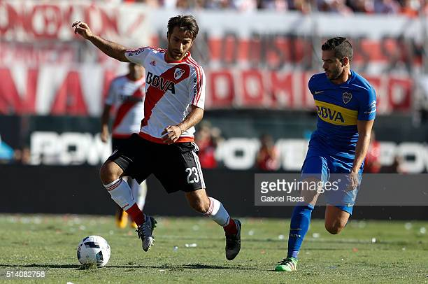 Leonardo Ponzio of River Plate fights for the ball with Fernando Gago of Boca Juniors during a match between River Plate and Boca Juniors as part of...