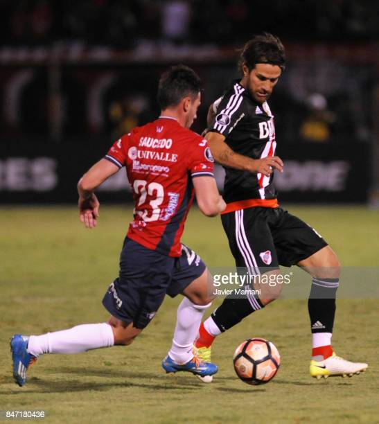 Leonardo Ponzio of River Plate fights for the ball with Fernando Saucedo of Wilstermann during a first leg match between Wilstermann and River Plate...