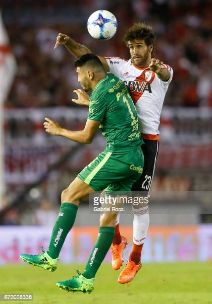 Leonardo Ponzio of River Plate fights for the ball with Gervasio Nuñez of Sarmiento during a match between River Plate and Sarmiento as part of...