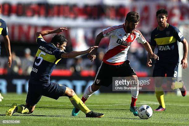 Leonardo Ponzio of River Plate in a action with Fernando Gago of Boca Juniors during the Argentine Primera Division match between River Plate and...