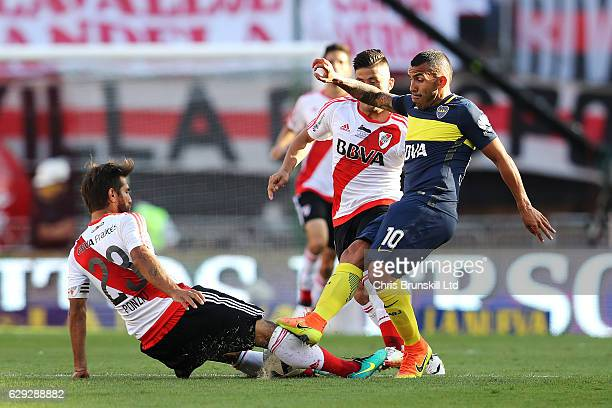 Leonardo Ponzio of River Plate in action with Carlos Tevez of Boca Juniors during the Argentine Primera Division match between River Plate and Boca...