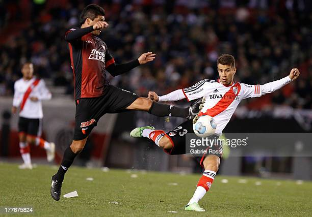 Leonardo Ponzio of River Plate kicks the ball during a match between River Plate and Colon de Santa Fe as part of the Torneo Inicial 2013 at...