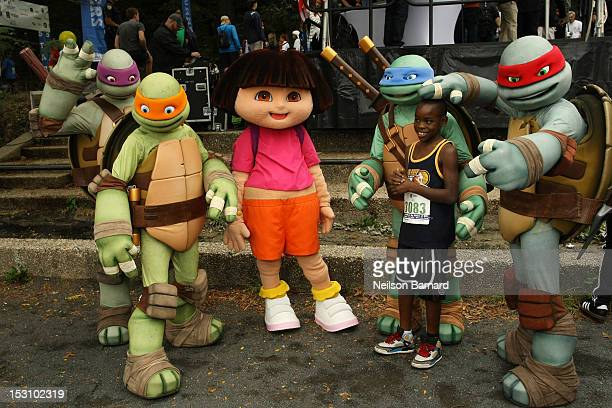 Leonardo Raphael Donatello and Michelangelo of The Teenage Mutant Ninja Turtles and Dora The Explorer attend the Nickelodeon World Wide Day of Play...