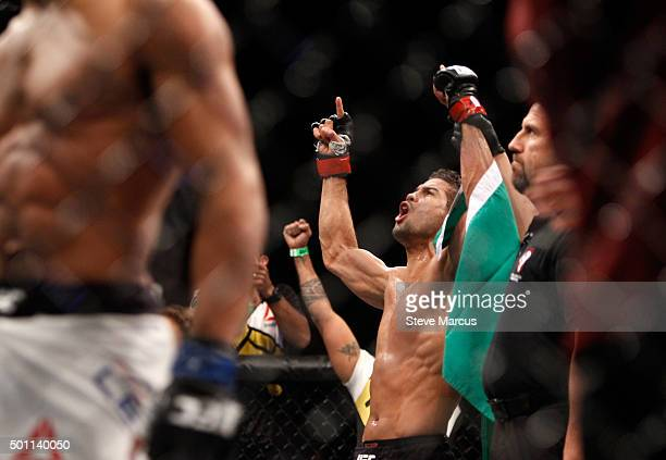 Leonardo Santos celebrates his victory over Kevin Lee in their lightweight fight during UFC 194 on December 12 2015 in Las Vegas Nevada