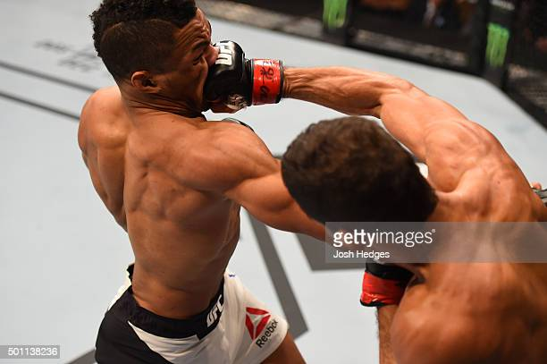 Leonardo Santos of Brazil punches Kevin Lee in their lightweight bout during the UFC 194 event inside MGM Grand Garden Arena on December 12 2015 in...