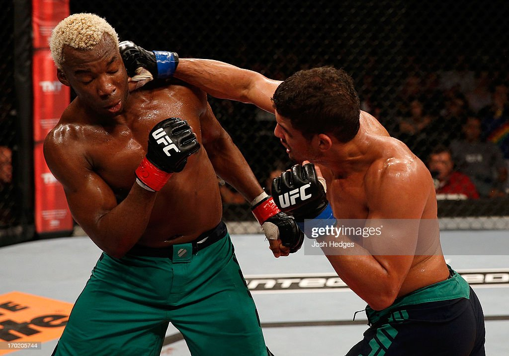 Leonardo Santos punches William 'Patolino' Macario in their welterweight fight during the UFC on FUEL TV event at Paulo Sarasate Arena on June 8, 2013 in Fortaleza, Ceara, Brazil.