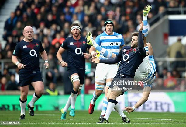 Leonardo Senatore of Argentina is taken out in the air by Elliot Daly of England during the Old Mutual Wealth Series match between England and...