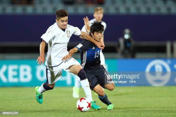 Leonardo Sernicola of Italy and Yuto Iwasaki of Japan battle for control of the ball during the FIFA U20 World Cup Korea Republic 2017 group D match...