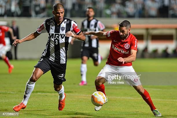 Leonardo Silva of Atletico MG and Lisandro Lopez of Internacional battle for the ball during a match between Atletico MG and Internacional as part of...
