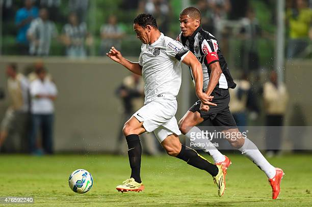 Leonardo Silva of Atletico MG and Ricardo Oliveira of Santos battle for the ball during a match between Atletico MG and Santos as part of Brasileirao...