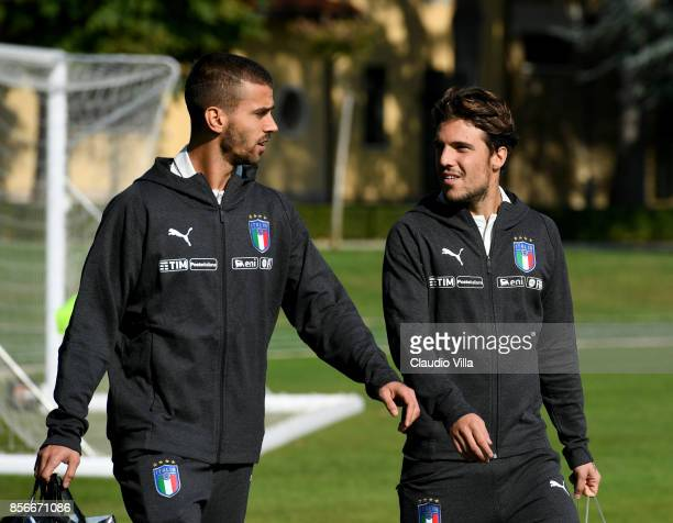 Leonardo Spinazzola and Simone Verdi of Italy chat during a training session at Italy club's training ground at Coverciano on October 2 2017 in...