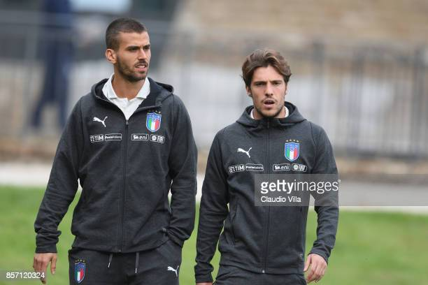 Leonardo Spinazzola and Simone Verdi of Italy look on prior to the training session at Italy club's training ground at Coverciano on October 3 2017...