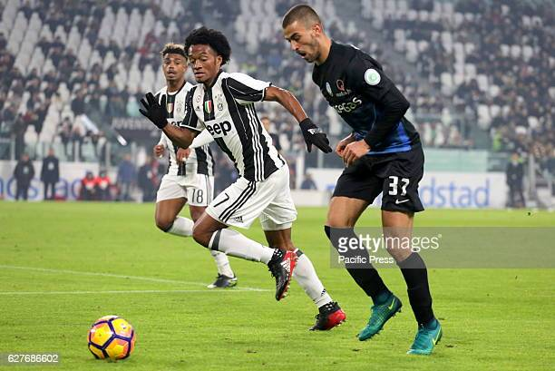 Leonardo Spinazzola of Atalanta and Juan Cuadrado of Juventus compete for the ball during the Serie A football match between Juventus FC and Atalanta...