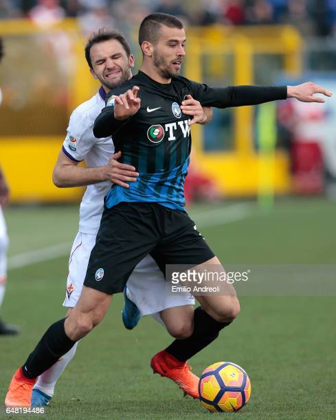 Leonardo Spinazzola of Atalanta BC competes for the ball with Milan Badelj of ACF Fiorentina during the Serie A match between Atalanta BC and ACF...