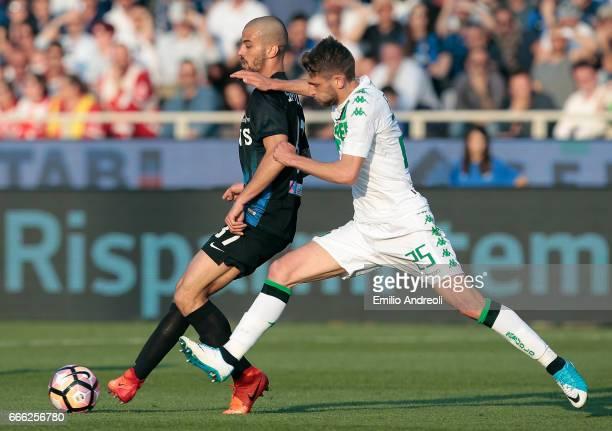 Leonardo Spinazzola of Atalanta BC competes for the ball with Domenico Berardi of US Sassuolo Calcio during the Serie A match between Atalanta BC and...