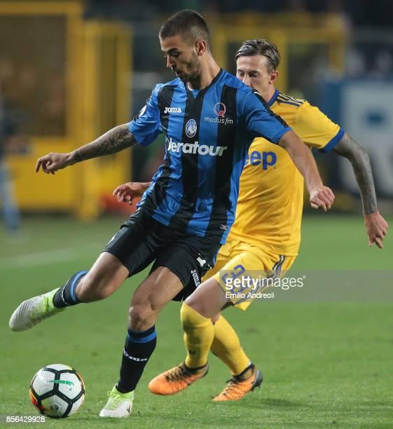 Leonardo Spinazzola of Atalanta BC is challenged by Federico Bernardeschi of Juventus FC during the Serie A match between Atalanta BC and Juventus at...
