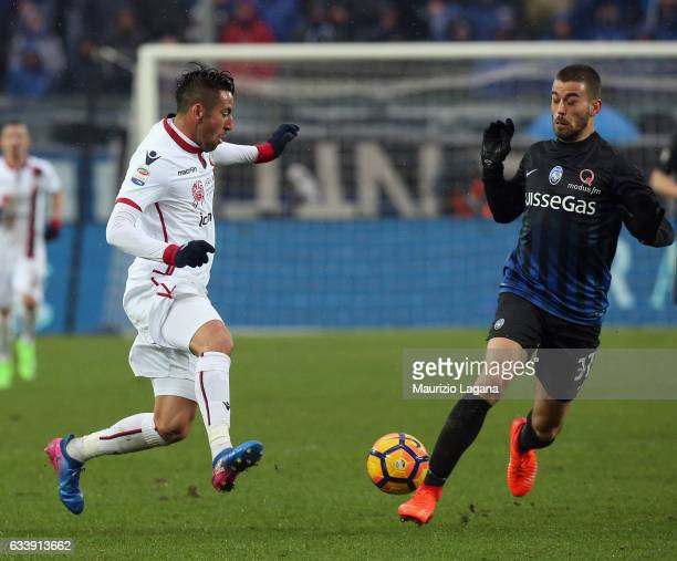 Leonardo Spinazzola of Atalanta competes for the ball with Mauricio Isla of Cagliari during the Serie A match between Atalanta BC and Cagliari Calcio...
