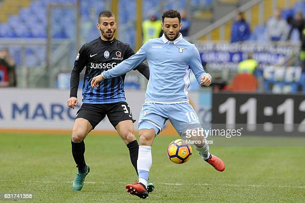 Leonardo Spinazzola of Atalnta BC compete for the ball with Felipe Anderson of SS Lazio during the Serie A match between SS Lazio and Atalanta BC at...