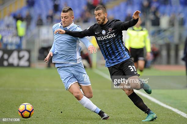 Leonardo Spinazzola of Atalnta BC compete for the ball with Sergej Milinkovic Savic of SS Lazio during the Serie A match between SS Lazio and...