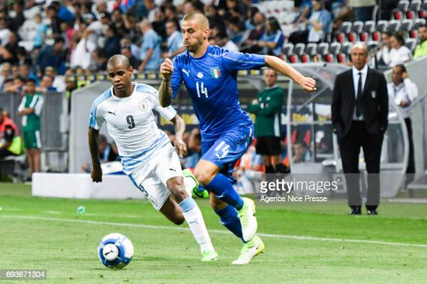 Leonardo Spinazzola of Italy and Diego Rolan of Uruguay during the International Friendly match between Italy and Uruguay on June 7 2017 in Nice...