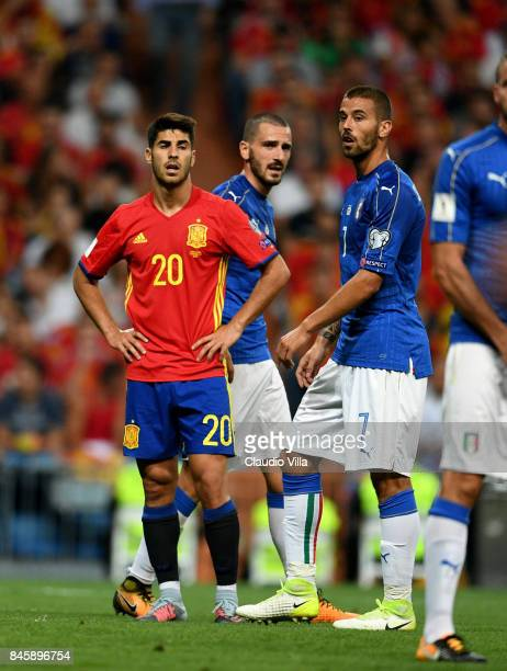 Leonardo Spinazzola of Italy and Marco Asensio of Spain look on during the FIFA 2018 World Cup Qualifier between Spain and Italy at Estadio Santiago...