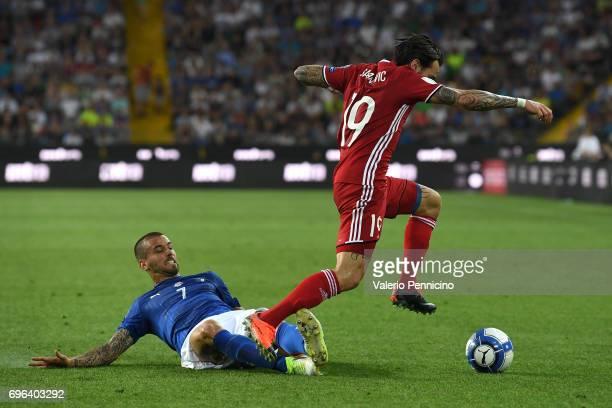 Leonardo Spinazzola of Italy ytackles Dennis Salanovic of Liechtenstein during the FIFA 2018 World Cup Qualifier between Italy and Liechtenstein at...