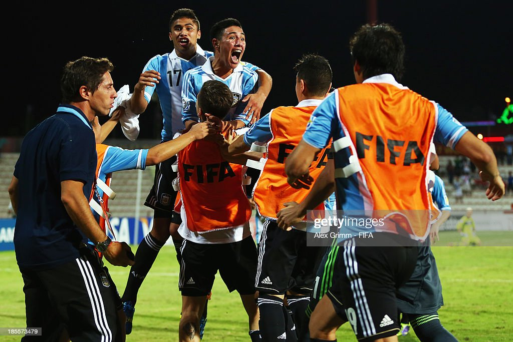 Leonardo Suarez (C) of Argentina celebrates his team's third goal with team mates during the FIFA U-17 World Cup UAE 2013 Group E match between Argentina and Austria at Al Rashid Stadium on October 22, 2013 in Dubai, United Arab Emirates.