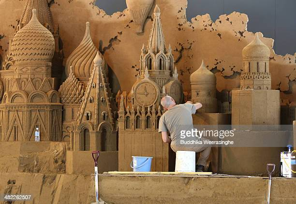 Leonardo Ugolini of Italy finishes a sand sculpture named 'Saint Basil Cathedral Moscow Kremlin' at the Sand Museum in the Tottori Dune on April 3...