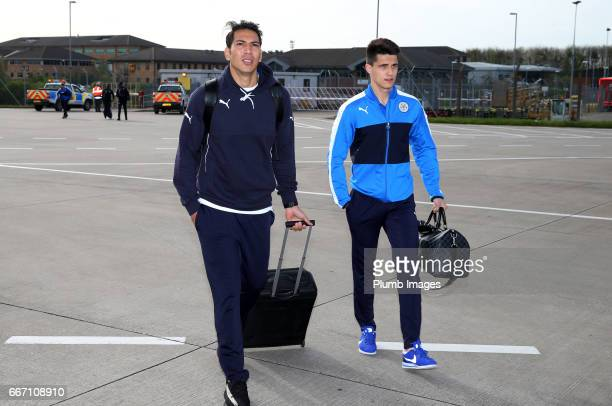 Leonardo Ulloa and Bartosz Kapustka of Leicester City board the plane from East Midlands Airport to Madrid for the Champions League Quarter Final on...