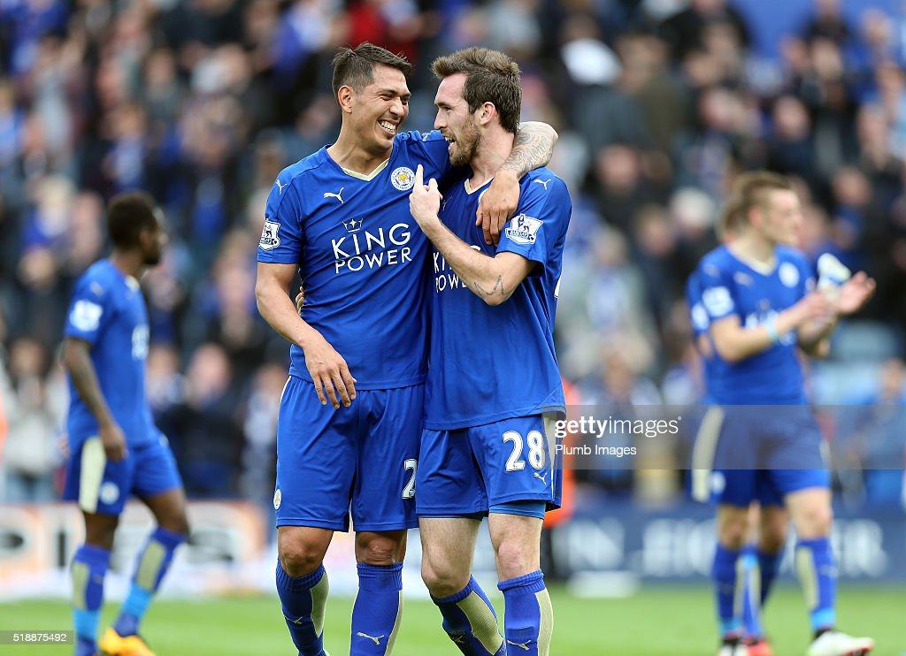 Leonardo Ulloa And Christian Fuchs of Leicester City celebrate at the final whistle after the Barclays Premier League match between Leicester City and Southampton at the King Power Stadium on April 03 , 2016 in Leicester, United Kingdom.