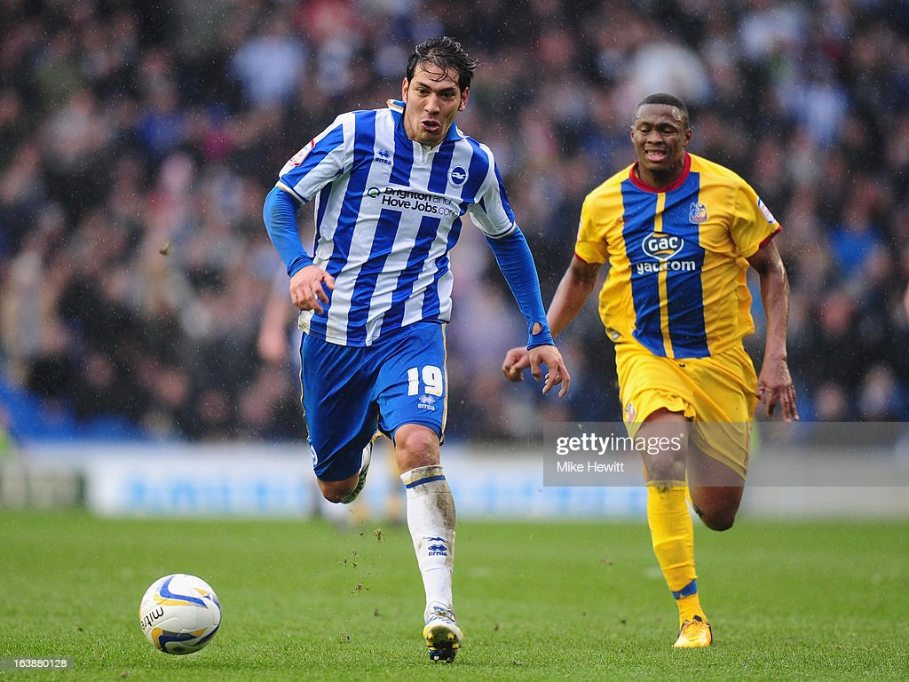 Leonardo Ulloa of Brighton gets away from <a gi-track='captionPersonalityLinkClicked' href=/galleries/search?phrase=Kagisho+Dikgacoi&family=editorial&specificpeople=4858795 ng-click='$event.stopPropagation()'>Kagisho Dikgacoi</a> of Crystal Palace during the npower Championship match between Brighton & Hove Albion and Crystal Palace at Amex Stadium on March 17, 2013 in Brighton, England.