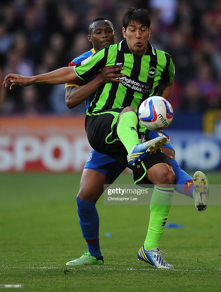 Leonardo Ulloa of Brighton holds of Kagisho Dikgacoi of Palace during the npower Championship Play Off Semi Final, First Leg at Selhurst Park on May 10, 2013 in London, England.