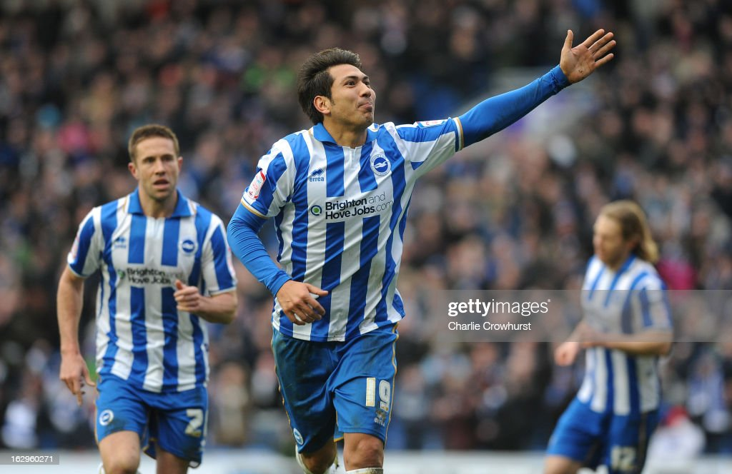 Leonardo Ulloa of Brighton & Hove Albion celebrates after he scores the teams and his second goal during the npower Championship match between Brighton & Hove Albion and Huddersfield Town at The Amex Stadium on March 02, 2013 in Brighton England.