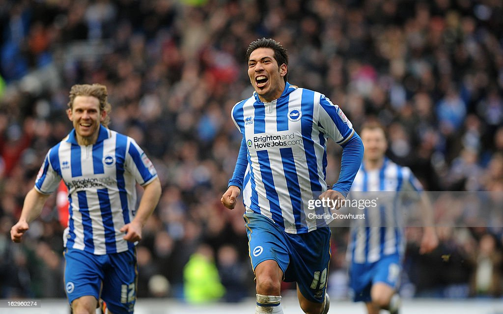 Leonardo Ulloa of Brighton & Hove Albion celebrates his hatrick during the npower Championship match between Brighton & Hove Albion and Huddersfield Town at The Amex Stadium on March 02, 2013 in Brighton England.