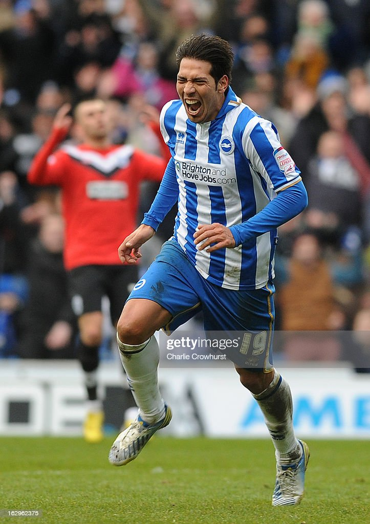 Leonardo Ulloa of Brighton & Hove Albion celebrates his hat-trick during the npower Championship match between Brighton & Hove Albion and Huddersfield Town at The Amex Stadium on March 02, 2013 in Brighton England.