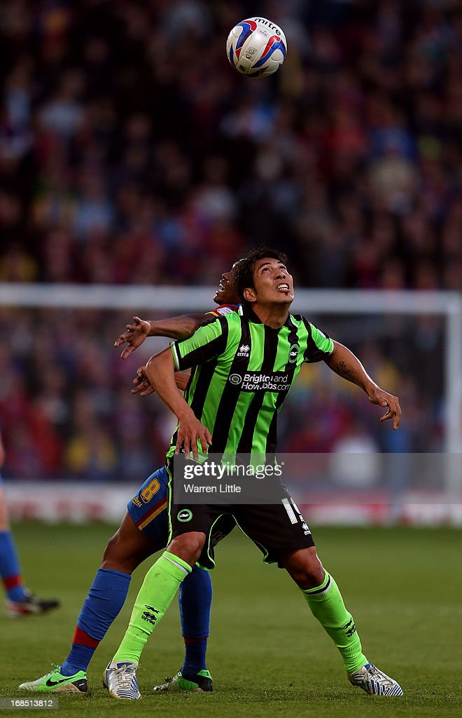 Leonardo Ulloa of Brighton & Hove Albion is tackled by Kagisho Dikgacoi of Crystal Palace during the npower Championship play off semi final first leg at Selhurst Park on May 10, 2013 in London, England.