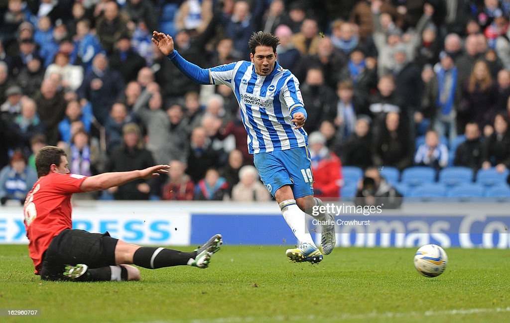 Leonardo Ulloa of Brighton & Hove Albion rounds Huddersfield keeper Amlex Smithies to score his hatrick during the npower Championship match between Brighton & Hove Albion and Huddersfield Town at The Amex Stadium on March 02, 2013 in Brighton England.