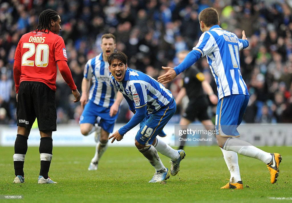 Leonardo Ulloa of Brighton & Hove Albion turns to celebrate after scoring his and the teams second goal during the npower Championship match between Brighton & Hove Albion and Huddersfield Town at The Amex Stadium on March 02, 2013 in Brighton England.