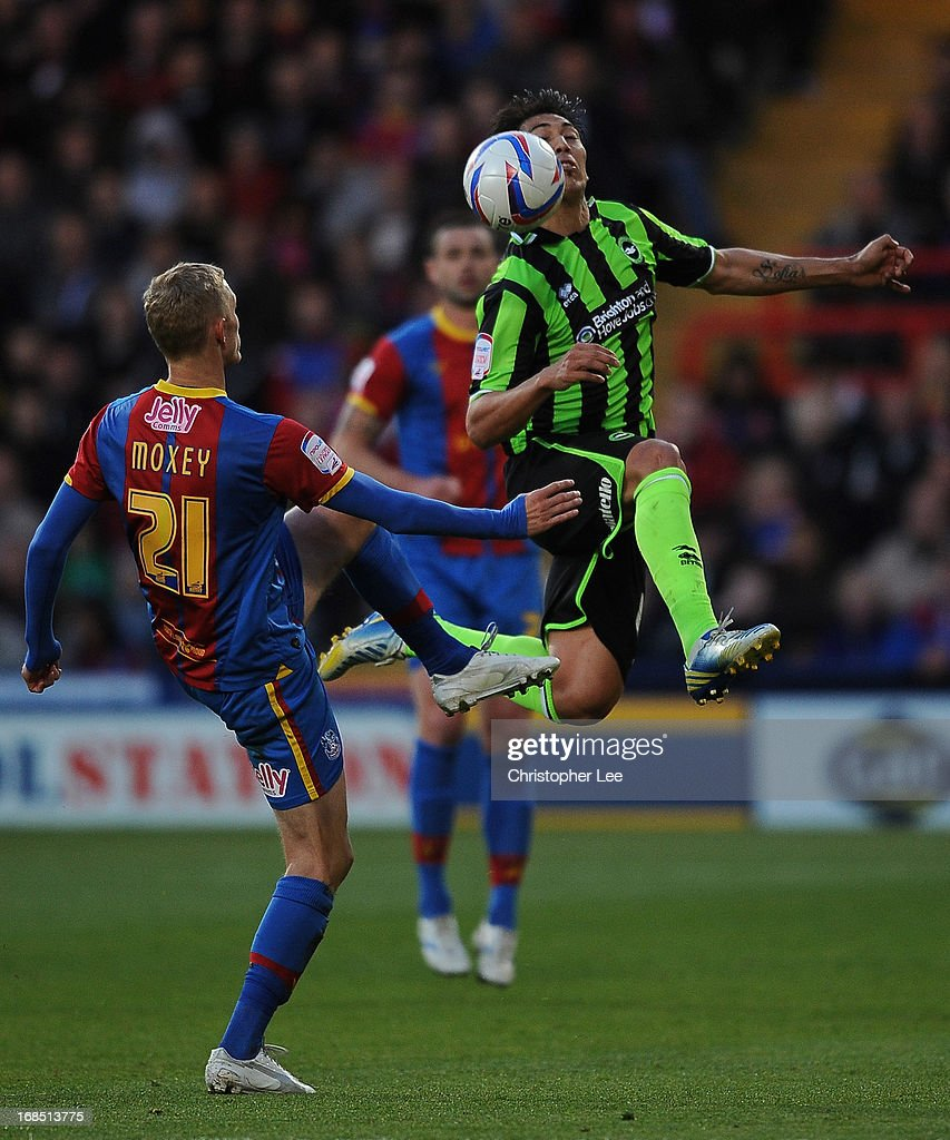 Leonardo Ulloa of Brighton jumps for the ball with Dean Moxey of Palace during the npower Championship Play Off Semi Final, First Leg at Selhurst Park on May 10, 2013 in London, England.
