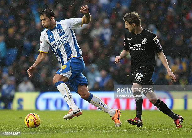 Leonardo Ulloa of Brighton looks to get past Bournemouth's Eunan O'Kane during the Sky Bet Championship match between Brighton Hove Albion and AFC...