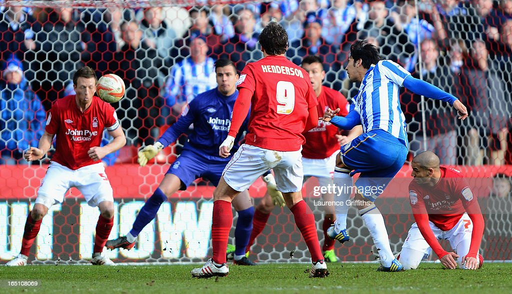 Leonardo Ulloa of Brighton scores the opening goal during the npower Championship match between Nottingham Forest and Brighton and Hove Albion at City Ground on March 30, 2013 in Nottingham, England.