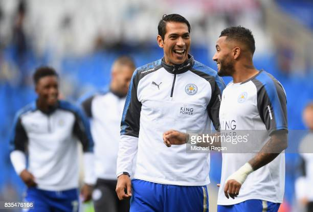 Leonardo Ulloa of Leicester City and Danny Simpson of Leiceter City speak on the pitch prior to the Premier League match between Leicester City and...