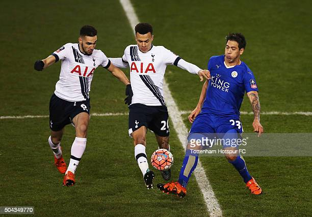 Leonardo Ulloa of Leicester City battles with Dele Alli and Nabil Bentaleb of Tottenham Hotspur during the Emirates FA Cup third round match between...