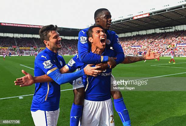 Leonardo Ulloa of Leicester City celebrates scoring the first goal with David Nugent and Jeffrey Schlupp of Leicester City during the Barclays...