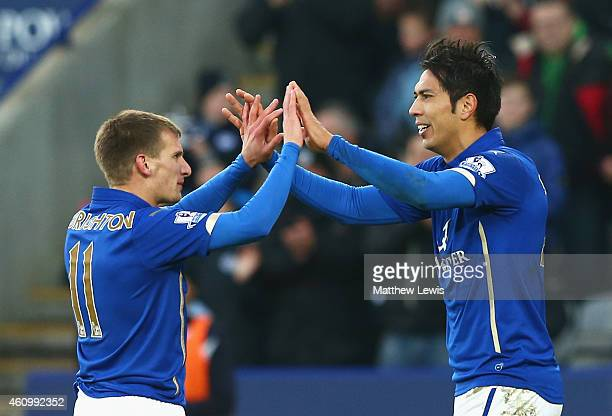 Leonardo Ulloa of Leicester City celebrates scoring the opening goal with Marc Albrighton of Leicester City during the FA Cup Third Round match...