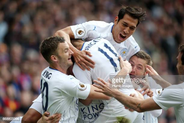 Leonardo Ulloa of Leicester City celebrates with Marc Albrighton Andy King and Jamie Vardy of Leicester City after Robert Huth of Leicester City...
