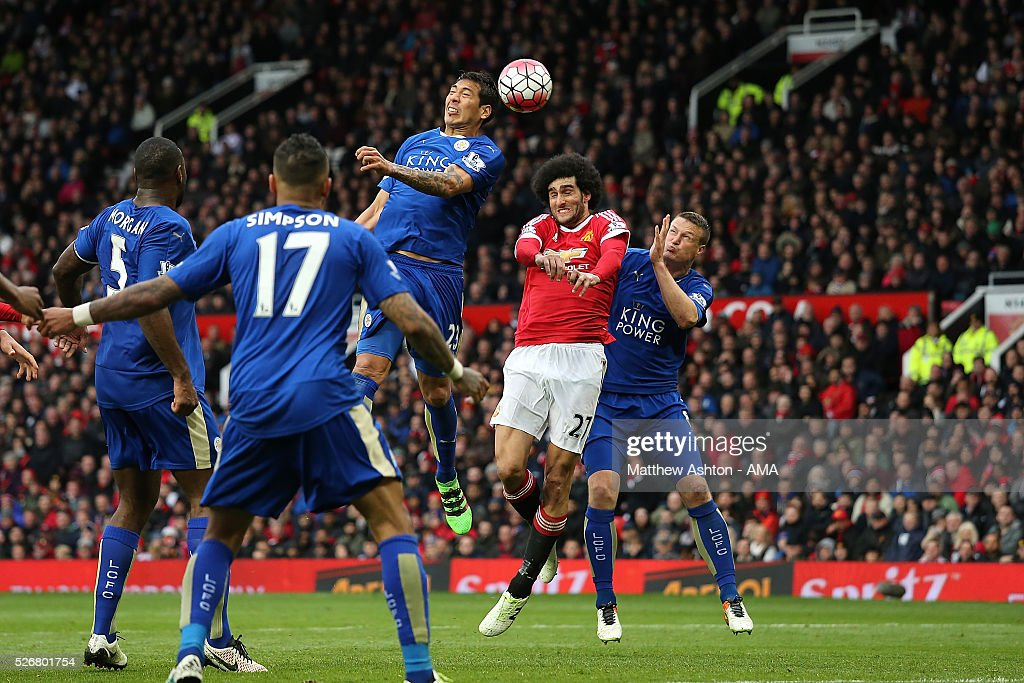 <a gi-track='captionPersonalityLinkClicked' href=/galleries/search?phrase=Leonardo+Ulloa&family=editorial&specificpeople=7433674 ng-click='$event.stopPropagation()'>Leonardo Ulloa</a> of Leicester City competes in the air with <a gi-track='captionPersonalityLinkClicked' href=/galleries/search?phrase=Marouane+Fellaini&family=editorial&specificpeople=3936316 ng-click='$event.stopPropagation()'>Marouane Fellaini</a> of Manchester United during the Barclays Premier League match between Manchester United and Leicester City at Old Trafford on May 1, 2016 in Manchester, United Kingdom.