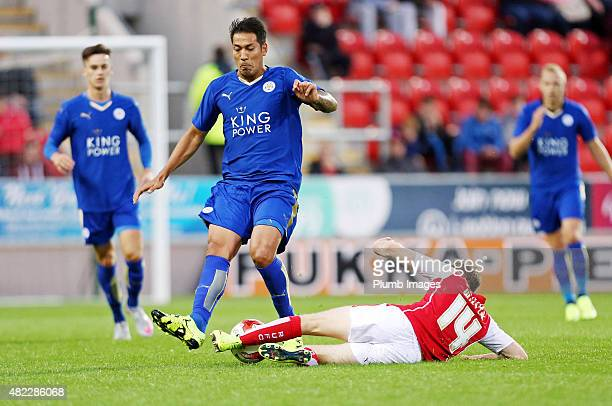 Leonardo Ulloa of Leicester City in action with Aidy White of Rotherham United during the preseason friendly between Rotherham and Leicester City at...